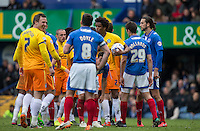 Sido Jombati of Wycombe Wanderers lets teammates know that he will be the one taking a free kick (which he scores from) during the Sky Bet League 2 match between Portsmouth and Wycombe Wanderers at Fratton Park, Portsmouth, England on 23 April 2016. Photo by Andy Rowland.
