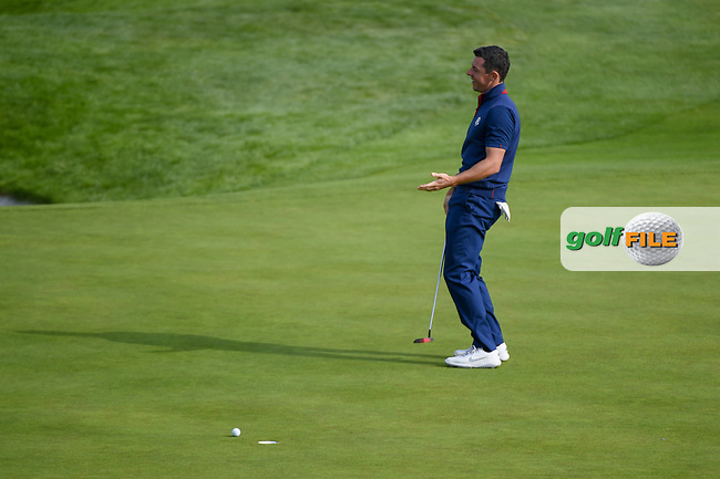 Rory McIlroy (Team Europe) reacts after barely missing his putt on 9 during Friday's foursomes of the 2018 Ryder Cup, Le Golf National, Guyancourt, France. 9/28/2018.<br /> Picture: Golffile | Ken Murray<br /> <br /> <br /> All photo usage must carry mandatory copyright credit (© Golffile | Ken Murray)