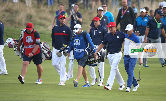 Alex Noren (Team Europe) walks to the 18th side by side with Bryson Dechambeau (Team USA) during Sunday's Singles, at the Ryder Cup, Le Golf National, Île-de-France, France. 30/09/2018.<br /> Picture David Lloyd / Golffile.ie<br /> <br /> All photo usage must carry mandatory copyright credit (© Golffile | David Lloyd)