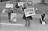 23 Oct 1972. Women activists protesting with images of children wounded during the war in Vietnam along the route of Richard Nixon's cortege in Westchester, a New York suburb. Republican President Richard Nixon is campaigning for Presidential re-election against the Democratic candidate Senator George McGovern.