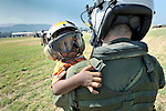 A boy evacuated from Jacmel, on Haiti's southern coast, arrives in Port-au-Prince on January 22 aboard a U.S. Navy helicopter and is escorted off the aircraft by a U.S. sailor. Hundreds of thousands of Haitians remain homeless and hungry in the wake of the country's devastating January 12 earthquake.