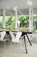 These Arne Jacobsen chairs around the dining table have been given an entirely different expression with motifs of street artist, Banksy, and the photographer, Karl Blossfeldt