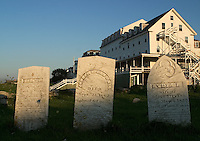 Old cemetery marks the graves of the notable Caswell family of Gosport, Star Island, Isles of Shoals. Oceanic Hotel, part of the Star Island Conference Center, is in the background. Photograph by Peter E. Randall