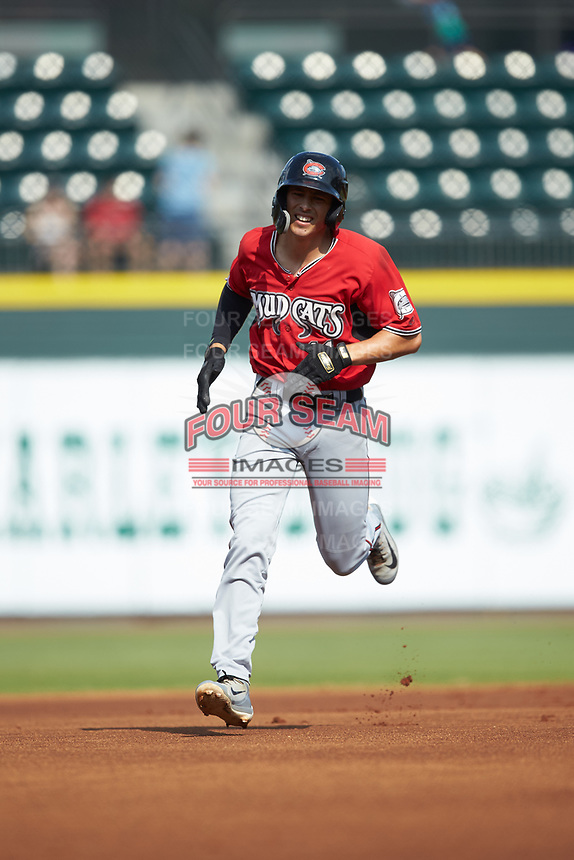 Ryan Aguilar (11) of the Carolina Mudcats rounds the bases after hitting a home run against the Winston-Salem Dash at BB&T Ballpark on June 1, 2019 in Winston-Salem, North Carolina. The Mudcats defeated the Dash 6-3 in game one of a double header. (Brian Westerholt/Four Seam Images)