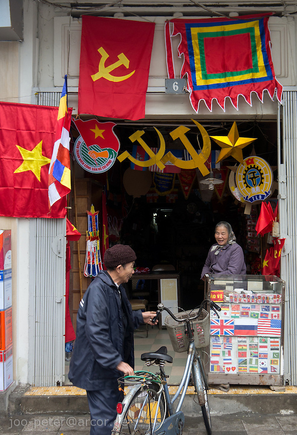 little shop for communist symbols (flags, busts of Ho Chi Minh and other items) in Hanoi, Vietnam