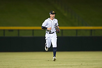 Mesa Solar Sox left fielder Daniel Woodrow (19), of the Detroit Tigers organization, jogs off the field between innings of an Arizona Fall League game against the Scottsdale Scorpions at Sloan Park on October 10, 2018 in Mesa, Arizona. Scottsdale defeated Mesa 10-3. (Zachary Lucy/Four Seam Images)