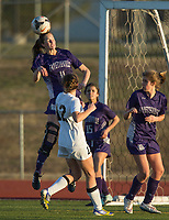 NWA Democrat-Gazette/BEN GOFF @NWABENGOFF<br /> Regan Resz of Fayetteville heads the ball Tuesday, March 13, 2018, during the match against Bentonville at Bentonville's Tiger Athletic Complex.