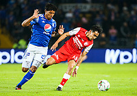 BOGOTA, COLOMBIA - MARCH 03: Kelvin Osorio of Santa Fe fights for the ball with against Carlos Pereira of Millonarios during the match between Millonarios and Independiente Santa Fe as part of the Liga BetPlay at Estadio El Campin on March 3, 2020 in Bogota, Colombia. (Photo by John W. Vizcaino/VIEW press/Getty Images)