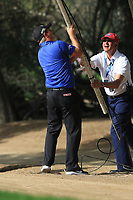 Callum Shinkwin (ENG) in the rough on the 2nd getting some assistance from a Referee during Round 4 of the Omega Dubai Desert Classic, Emirates Golf Club, Dubai,  United Arab Emirates. 27/01/2019<br /> Picture: Golffile | Thos Caffrey<br /> <br /> <br /> All photo usage must carry mandatory copyright credit (&copy; Golffile | Thos Caffrey)