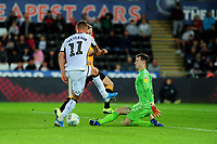 Kristoffer Peterson of Swansea City miss-hits his shot during the Carabao Cup Second Round match between Swansea City and Cambridge United at the Liberty Stadium in Swansea, Wales, UK. Wednesday 28, August 2019.