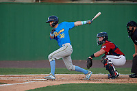 Myrtle Beach Pelicans Zac Taylor (32) at bat in front of catcher Jakson Reetz and umpire Josh Gilreath during a Carolina League game against the Potomac Nationals on August 14, 2019 at Northwest Federal Field at Pfitzner Stadium in Woodbridge, Virginia.  Potomac defeated Myrtle Beach 7-0.  (Mike Janes/Four Seam Images)