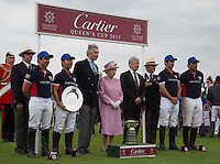Cartier Trophy Winning Team (King Power) pose with Her Majesty the Queen during the Cartier Queens Cup Final match between King Power Foxes and Dubai Polo Team at the Guards Polo Club, Smith's Lawn, Windsor, England on 14 June 2015. Photo by Andy Rowland.