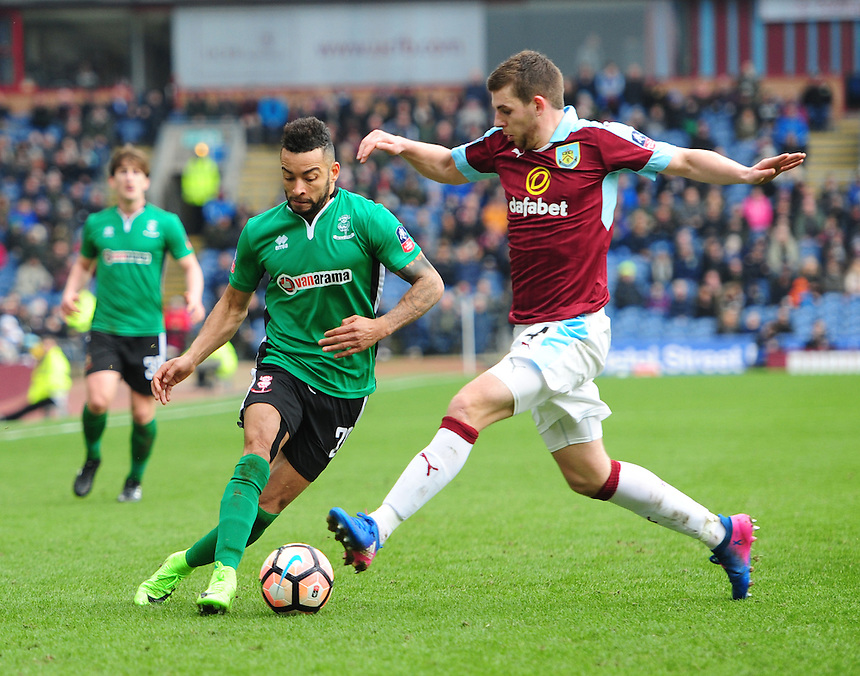 Lincoln City's Nathan Arnold vies for possession with Burnley's Jon Flanagan<br /> <br /> Photographer Chris Vaughan/CameraSport<br /> <br /> Emirates FA Cup Fifth Round - Burnley v Lincoln City - Saturday 18th February 2017 - Turf Moor - Burnley <br />  <br /> World Copyright &copy; 2017 CameraSport. All rights reserved. 43 Linden Ave. Countesthorpe. Leicester. England. LE8 5PG - Tel: +44 (0) 116 277 4147 - admin@camerasport.com - www.camerasport.com