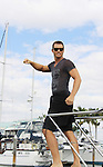 Days Eric Martsolf  takes a break on Blondi, Marco Island at SoapFest's Celebrity Weekend - Cruisin' and Schmoozin' on the Marco Island Princess - mix and mingle and watching dolphins - autographs, photos, live auction raising money for kids on November 11, 2012 Marco Island, Florida. (Photo by Sue Coflin/Max Photos)