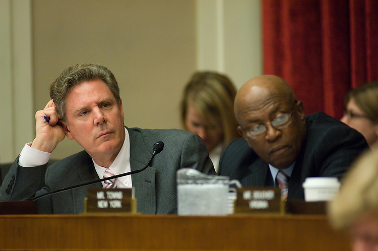 WASHINGTON, DC - April 02: Rep. Frank Pallone Jr., D-N.J., and Rep. Edolphus Towns, D-N.Y., during the House Energy markup of tobacco legislation. House Energy Chairman John D. Dingell, D-Mich.,  has persuaded two key interest groups to drop their opposition to legislation that would require the FDA to regulate tobacco, clearing the way for committee approval of the bill this week. The Energy and Commerce Committee, will begin considering the measure (HR 1108) Wednesday. But significant opposition to the bill remains, and Republicans could offer many amendments. The National Association of Convenience Stores, a longtime opponent of Food and Drug Administration (FDA) tobacco regulation, dropped its opposition this week after Dingell, D-Mich., agreed to change many provisions of the bill pertaining to the regulation of retail sales of tobacco products, said Lyle Beckwith, vice president for government relations at the association. Dingell also agreed to include language in the bill that would explicitly allow convenience stores to sell smoking-cessation products such as Nicorette chewing gum, Beckwith said. (Photo by Scott J. Ferrell/Congressional Quarterly)