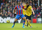Crystal Palace's Jordan Ayew is challenged by Arsenal's Sokratis Papastathopoulos during the Premier League match at Selhurst Park, London. Picture date: 11th January 2020. Picture credit should read: Paul Terry/Sportimage