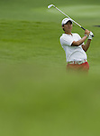 SINGAPORE - MARCH 05:  Yani Tseng of Taiwan plays a shot on the par five 15th hole during the first round of HSBC Women's Champions at the Tanah Merah Country Club on March 5, 2009 in Singapore. Photo by Victor Fraile / The Power of Sport Images