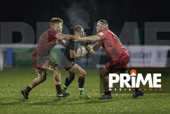 Craig Holland of London Scottish is tackled during the Greene King IPA Championship match between London Scottish Football Club and Jersey Reds at Richmond Athletic Ground, Richmond, United Kingdom on 16 March 2018. Photo by David Horn.