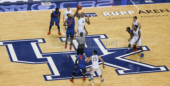 Kentucky forward Karl-Anthony Towns and Florida center Jon Horford jump for the ball at tip-off during the first half of the Kentucky vs. Florida game at Rupp Arena in Lexington, Ky.,on Saturday, March 7, 2015. UK defeated Florida 67-50, completing a perfect regular season. Photo by Adam Pennavaria | Staff