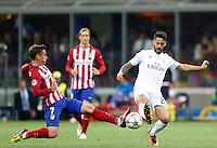 Calcio, finale di Champions League: Real Madrid vs Atletico Madrid. Stadio San Siro, Milano, 28 maggio 2016.<br /> Real Madrid's Isco, right, is tackled by Atletico Madrid Antoine Griezmann during the Champions League final match between Real Madrid and Atletico Madrid, at Milan's San Siro stadium, 28 May 2016.<br /> UPDATE IMAGES PRESS/Isabella Bonotto