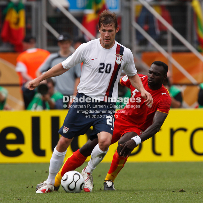 NUREMBERG, GERMANY - JUNE 22:  Brian McBride of the United States (l) controls the ball against John Mensah of Ghana (r) during a 2006 FIFA World Cup soccer match June 22, 2006 in Nuremberg, Germany.  (Photograph by Jonathan P. Larsen)