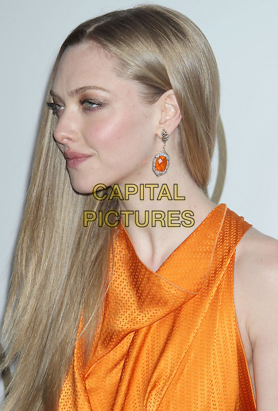 Amanda Seyfried.At the 24th Annual Producers Guild Awards held at the Beverly Hilton Hotel, Beverly Hills, California, USA,.26th January 2013..PGAs PGA arrivals headshot portrait cowl neck profile dangling earrings orange  sleeveless  .CAP/ADM/RE.©Russ Elliot/AdMedia/Capital Pictures.