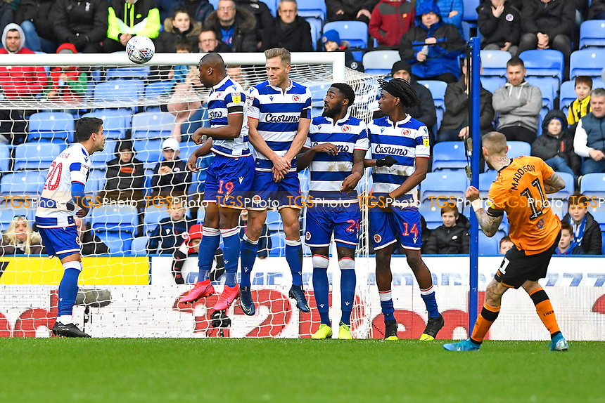 Marcus Maddison of Hull City right takes a free kick over the Referee Andy Davies wall during Reading vs Hull City, Sky Bet EFL Championship Football at the Madejski Stadium on 8th February 2020