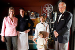 L-R: Foreign Cinema chef and owners, Gayle Pirie, with her husband, John Clark, their children, Magnus, 10, and Pearl, 3, and Gayle's father, Greig Pirie, stand near a projector upstairs of their restaurant, on Friday, June 12, 2009..