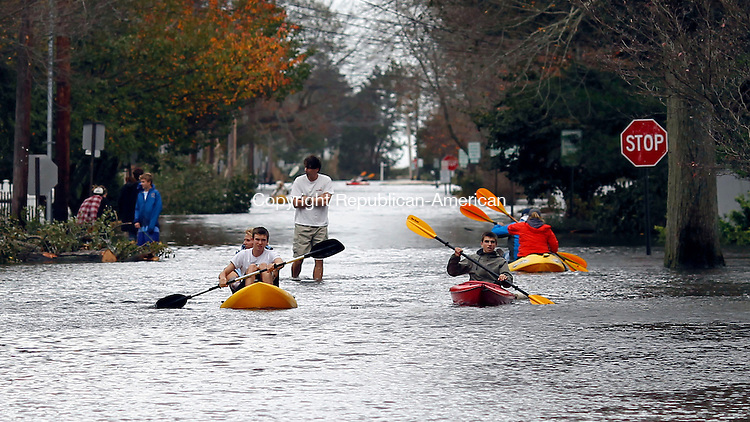 Fairfield, CT-30 October 2012-103012CM08-  People had to use kayaks to navigate their way around Lalley Blvd and Quincy Street Tuesday morning in Fairfield.  Many folks in the neighbored couldn't get to their home as others spent the morning cleaning up from Hurricane Sandy, a storm that caused major power outages and heavy flooding.  Christopher Massa Republican-American
