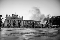 A cloud of smoke is raised high after a Carabinieri (military police) truck is set on by outraged fringes of  rioters in Piazza San Giovanni.  Rome, Italy. 15/10/2011