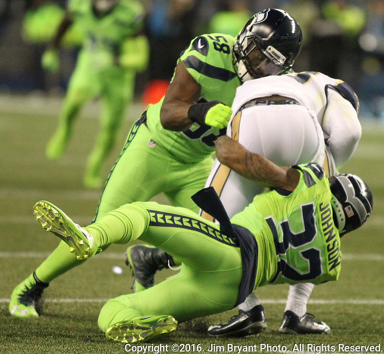 Seattle Seahawks strong safety Jerome Johnson and outside linebacker Kevin Pierre-Louis (58) team up to bring down Los Angeles Rams tight end Lance Kendricks (88) at CenturyLink Field in Seattle, Washington on December 15, 2016.  The Seahawks beat the Rams 24-3.  ©2016. Jim Bryant Photo. All Rights Reserved