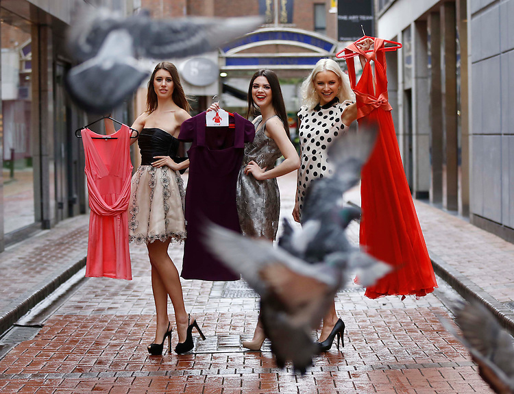 "No Repro Fee..Models, Joanne Northey,(left) with Clare MacDougald and Teo Sutra (right), pictured holding dresses donated by Nuala Carey, Lisa Cannon and Caroline Harrington in Dublin at the launch of the ""Buy My Dress 2013"" supported by Kellogg's Special K in aid of the Down Syndrome Centre which takes place around the country on the 26th May. Pic. Robbie Reynolds"