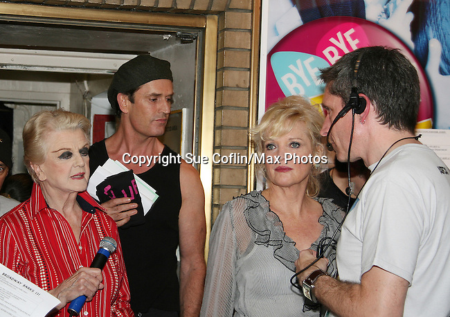 """Blithe Spiriit - Angela Lansbury, Rupert Everett, Christine Ebersole at Broadway Barks 11 - a """"Pawpular"""" star-studded dog and cat adopt-a-thon on July 11, 2009 in Shubert Alley, New York City, NY. (Photo by Sue Coflin/Max Photos)"""