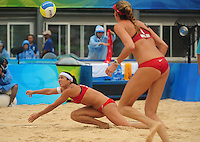 Aug. 10, 2008; Beijing, CHINA; Misty May-Treanor (left) dives for a shot as Kerri Walsh looks on against Japan during the womens beach volleyball at the Chaoyang Park Beach Volleyball Ground in the 2008 Beijing Olympic Games. The United States won the match. Mandatory Credit: Mark J. Rebilas-