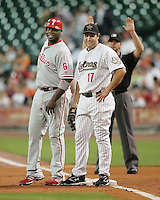 Phillies 1B Ryan Howard visits with Astros 1B Lance Berkman on Thursday May 22nd at Minute Maid Park in Houston, Texas. Photo by Andrew Woolley / Four Seam Images.
