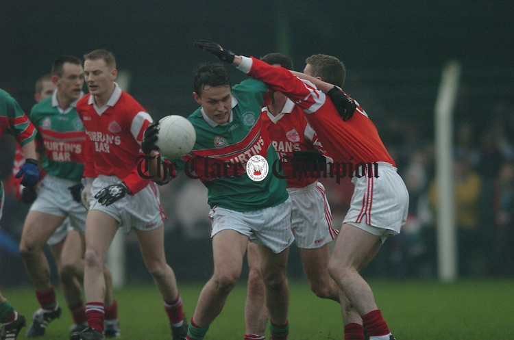 Kilmurry Ibrickane's Peter O Dwyer gets tangled with Stradbally's John Hearne. Photograph by John Kelly.