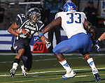 Nevada's Aaron Bradley runs against Boise State defender Tommy Smith during the second half of an NCAA college football game on Saturday, Dec. 1, 2012,  in Reno, Nev. Boise State won 27-21. (AP Photo/Cathleen Allison)