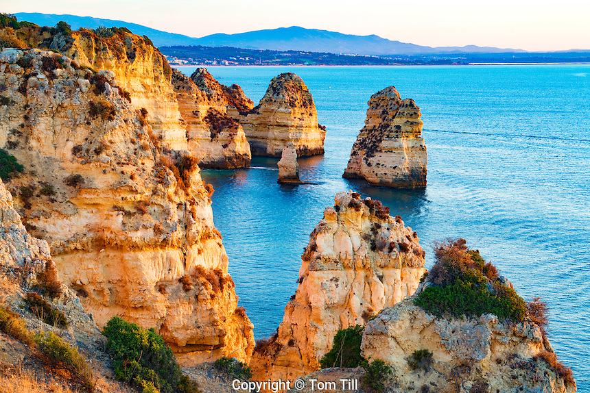Coastal seastacks at sunrise near Lagos, Portugal, Atlantic Ocean