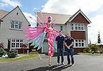Cardiff Blues, Wales and British and Irish Lions player Alex Cuthbert and Cardiff Blues Rhys Williams with one of the Stilt walkers from Vertigo Stilts<br /> <br /> <br /> Redrow Homes Official opening of  at Belle View at Mon Bank Newport with Cardiff Blues Players Alex Cuthbert and Rhys Williams - Newport <br /> <br /> &copy; www.sportingwales.com- PLEASE CREDIT IAN COOK
