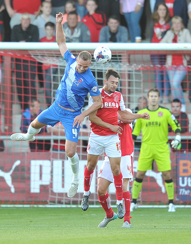 Hartlepool United's Harry Worley out jumps Fleetwood Town's Lyle Della Verde<br /> <br /> Photographer Dave Howarth/CameraSport<br /> <br /> Football - Capital One Cup First Round - Fleetwood Town v Hartlepool United - Tuesday 11th August 2015 - Highbury Stadium - Fleetwood<br />  <br /> &copy; CameraSport - 43 Linden Ave. Countesthorpe. Leicester. England. LE8 5PG - Tel: +44 (0) 116 277 4147 - admin@camerasport.com - www.camerasport.com