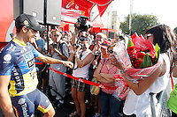 Alberto Contador's  celebrates with his mother and wife the victory in La Vuelta after the stage of La Vuelta 2012 beetwen Cercedilla and Madrid the stage of La Vuelta 2012 beetwen Cercedilla and Madrid.September 9,2012. (ALTERPHOTOS/Paola Otero)