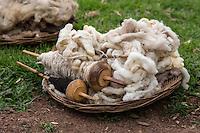 Peru, Urubamba Valley, Quechua Village of Misminay.  Wool After Washing in Natural Organic Detergent.  Unwashed Wool in Background..