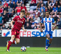 Ben Woodburn of Liverpool & Nathan Byrne of Wigan Athletic during the pre season friendly match between Wigan Athletic and Liverpool at the DW Stadium, Wigan, England on 14 July 2017. Photo by Andy Rowland.