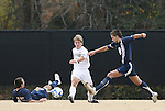 02 December 2007: Wake Forest's Jamie Franks (center) plays the ball between West Virginia's Mike Anoia (15) and Dan Stratford (ENG) (8). The Wake Forest University Demon Deacons defeated the West Virginia University Mountaineers 3-1 at W. Dennie Spry Soccer Stadium in Winston-Salem, North Carolina in a Third Round NCAA Division I Mens Soccer Tournament game.
