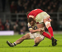 Wales' Alun Wyn Jones is tackled by Englands' Sam Simmonds<br /> <br /> Photographer Bob Bradford/CameraSport<br /> <br /> NatWest Six Nations Championship - England v Wales - Saturday 10th February 2018 - Twickenham Stadium - London<br /> <br /> World Copyright &copy; 2018 CameraSport. All rights reserved. 43 Linden Ave. Countesthorpe. Leicester. England. LE8 5PG - Tel: +44 (0) 116 277 4147 - admin@camerasport.com - www.camerasport.com