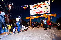 John Baker at the finish line in Nome places 5th during the 2010 Iditarod