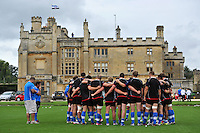 The Bath players huddle togther outside Farleigh House. Bath Rugby training session on August 21, 2012 at Farleigh House in Bath, England. Photo by: Patrick Khachfe/Onside Images