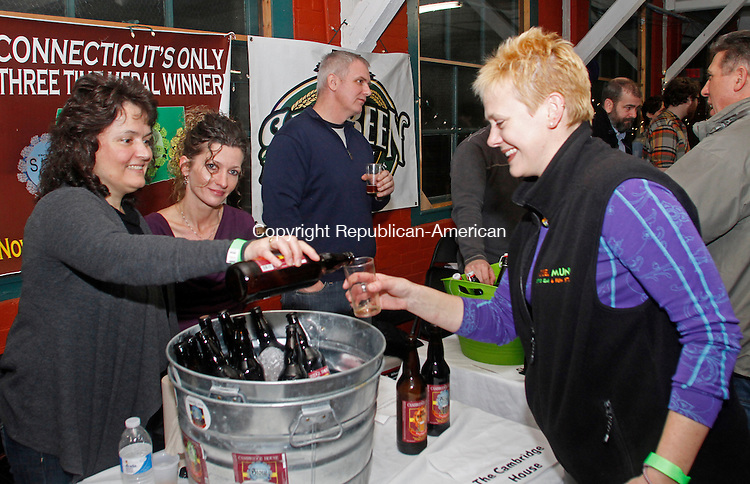 Winsted, CT-011814MK10 Kim Best from Naugatuck's Cambridge House Brewery pours a sample to Bridgette Rouleau as Hilde Previs looks on during the first annual Pints for a Purpose beer tasting and a concert to benefit the Northwest YMCA's Strong Kids campaign at Whiting Mills Saturday night in Winsted. Winsted YMCA branch director Jay Cohen said over a hundred beer enthusiasts came to enjoy seventeen local breweries and the proceeds will benefit the local community and families in need. Michael Kabelka / Republican-American