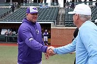 CHAPEL HILL, NC - FEBRUARY 19: Head coach Craig Cozart #38 of High Point University shakes hands with head coach Mike Fox #30 of the University of North Carolina during a game between High Point and North Carolina at Boshamer Stadium on February 19, 2020 in Chapel Hill, North Carolina.