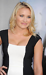 WESTWOOD, CA- AUGUST 07: Actress Emily Osment arrives at the Los Angeles premiere of 'Elysium' at Regency Village Theatre on August 7, 2013 in Westwood, California.